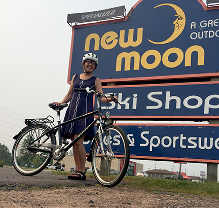 Allison Slavik of Cable, WI, poses with her new Uptown Breezer assembled at New Moon.