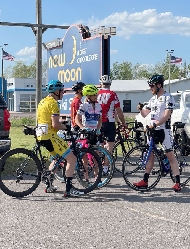 Road riders discuss the route