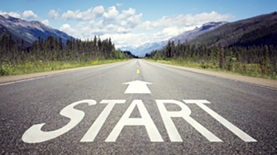 Start written on a road going into the mountains
