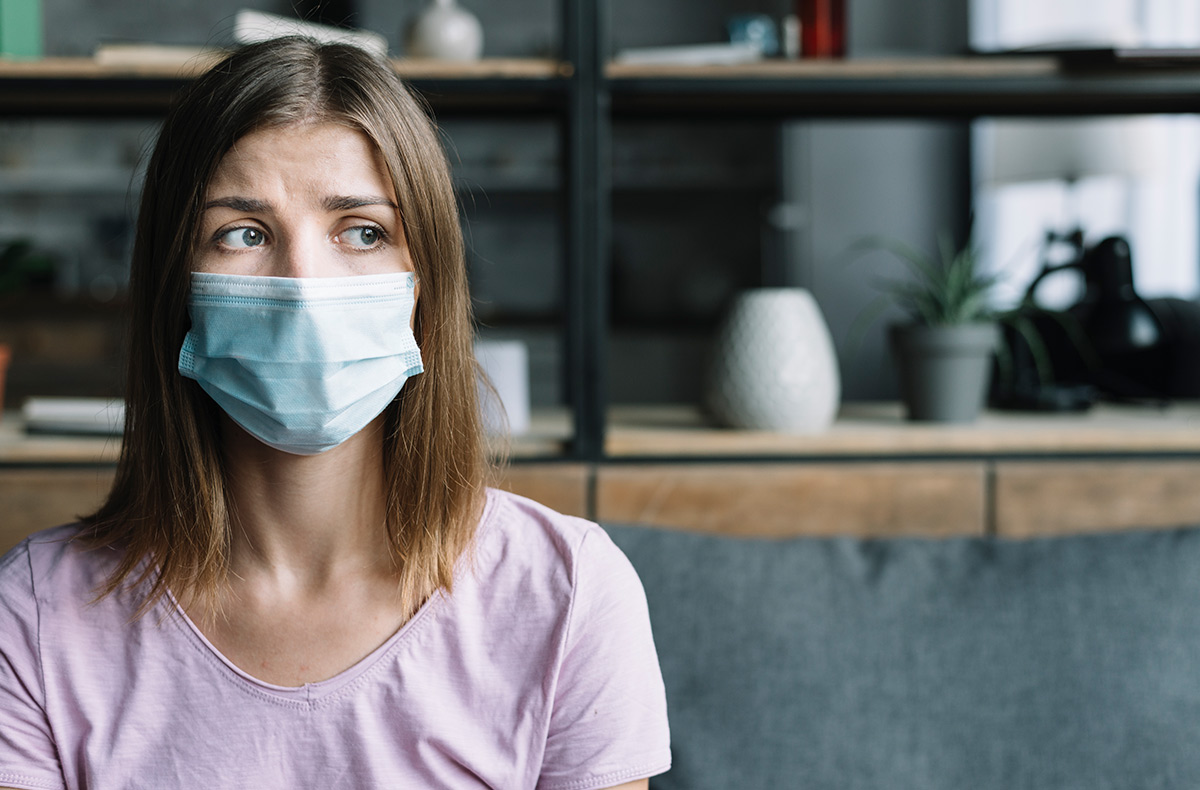 Woman with mask on. Clean Air Know the Facts