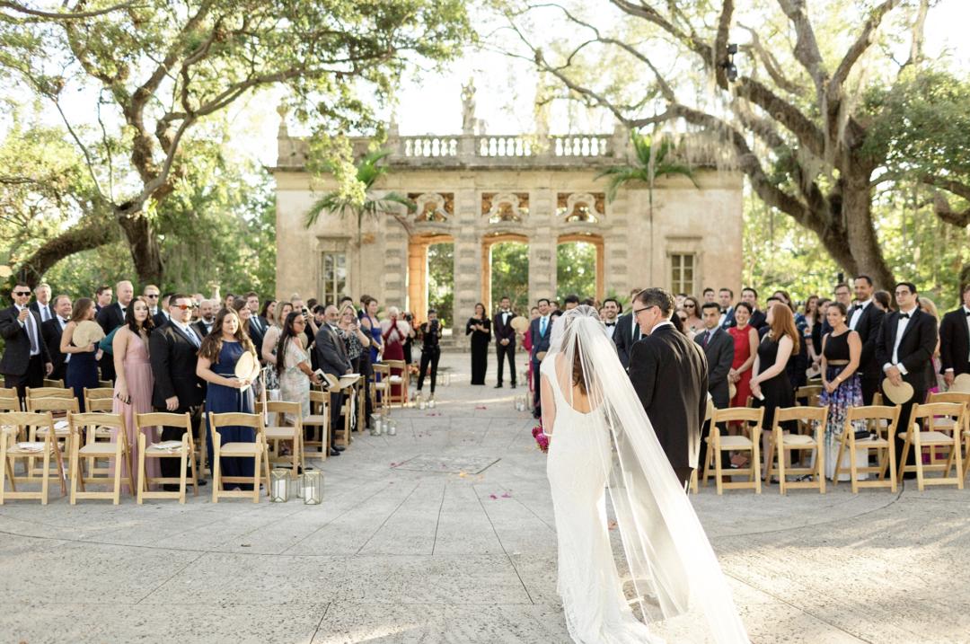 A unique Vizcaya Museum Wedding in Miami The Creatives Loft Weddings Miami bride walking the aisle with father