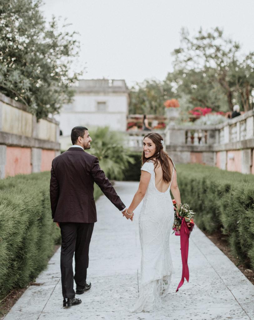 A unique Vizcaya Museum Wedding in Miami The Creatives Loft Weddings Miami Couple looking back