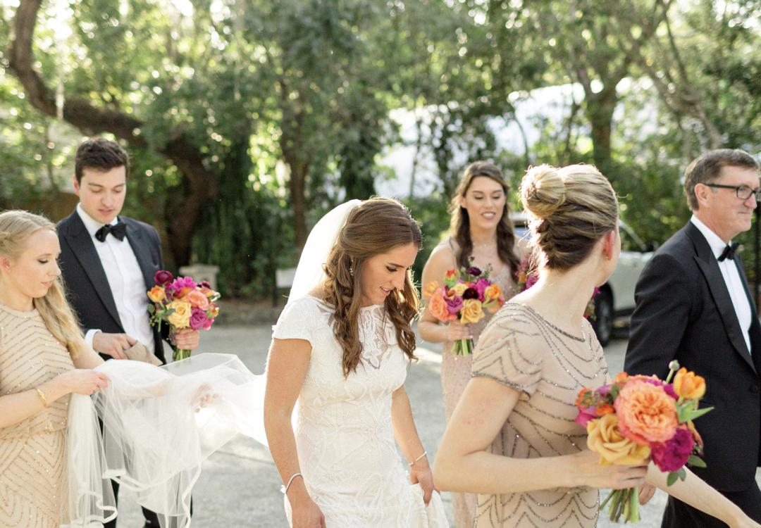A unique Vizcaya Museum Wedding in Miami The Creatives Loft Weddings Miami escorting the bride