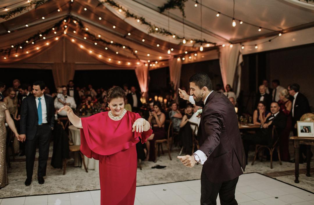 A unique Vizcaya Museum Wedding in Miami The Creatives Loft Weddings Miami groom dancing with mom