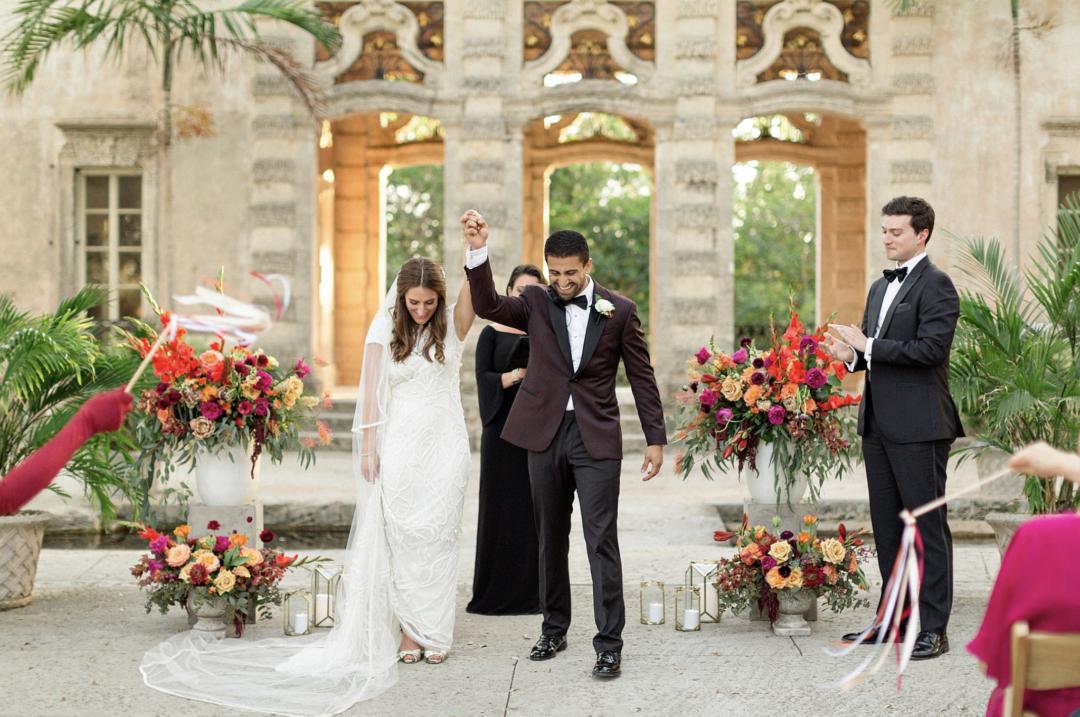 A unique Vizcaya Museum Wedding in Miami The Creatives Loft Weddings Miami Recessional Walk by the couple
