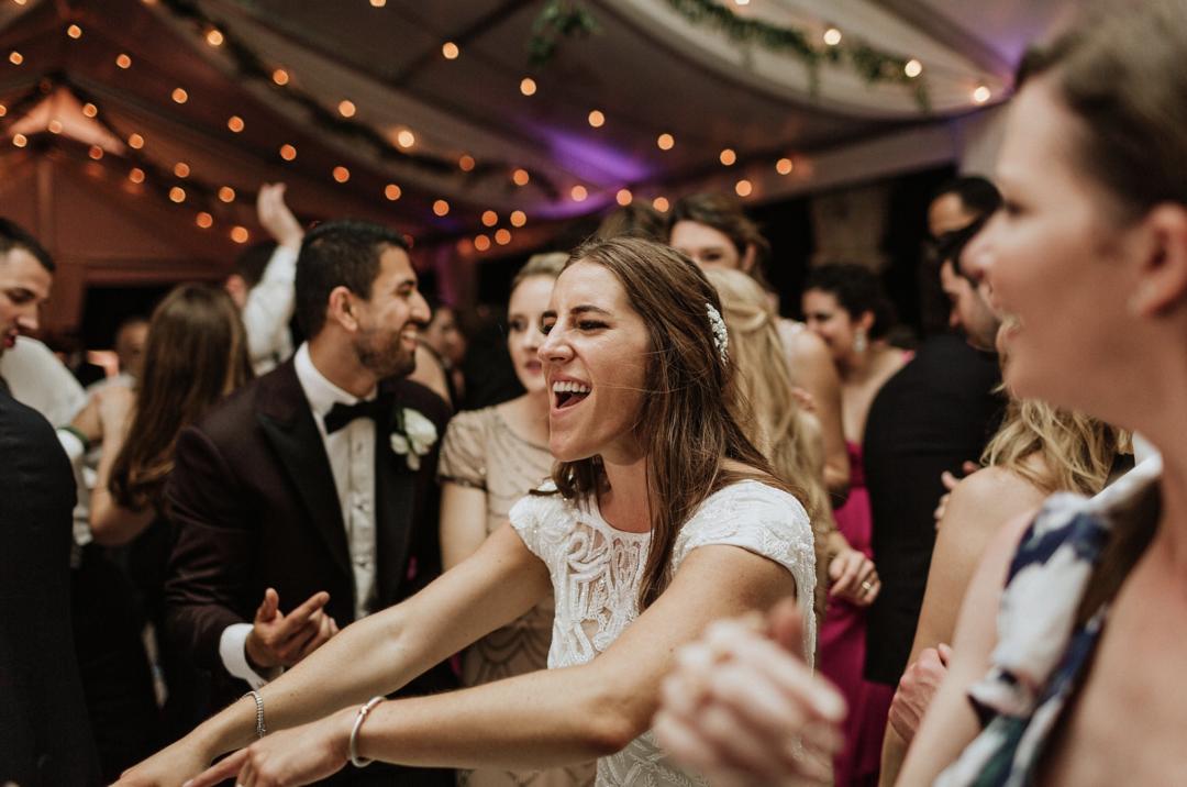 A unique Vizcaya Museum Wedding in Miami The Creatives Loft Weddings Miami bride dancing in the dance floor