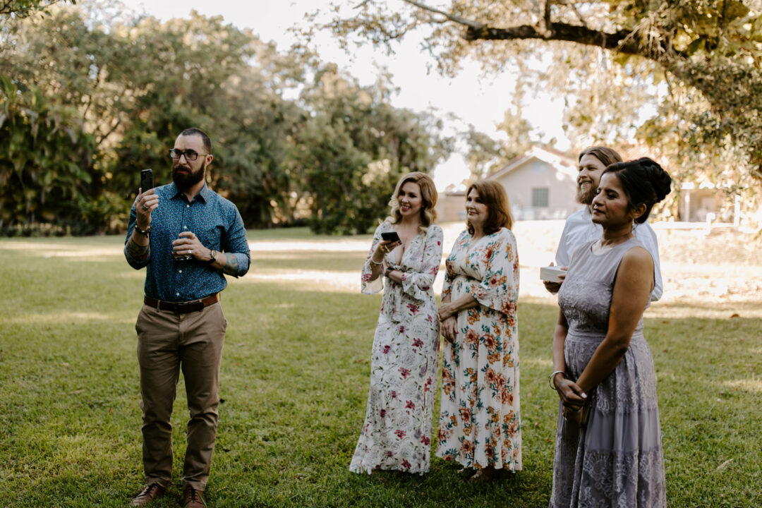 Miami Bohemian Elopement Wedding The Creative's Loft Guests Staring at couple