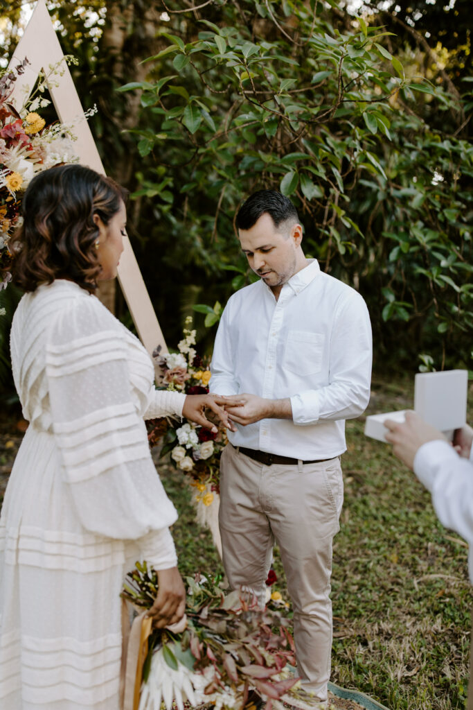Miami Bohemian Elopement Wedding The Creative's Loft Groom putting the ring