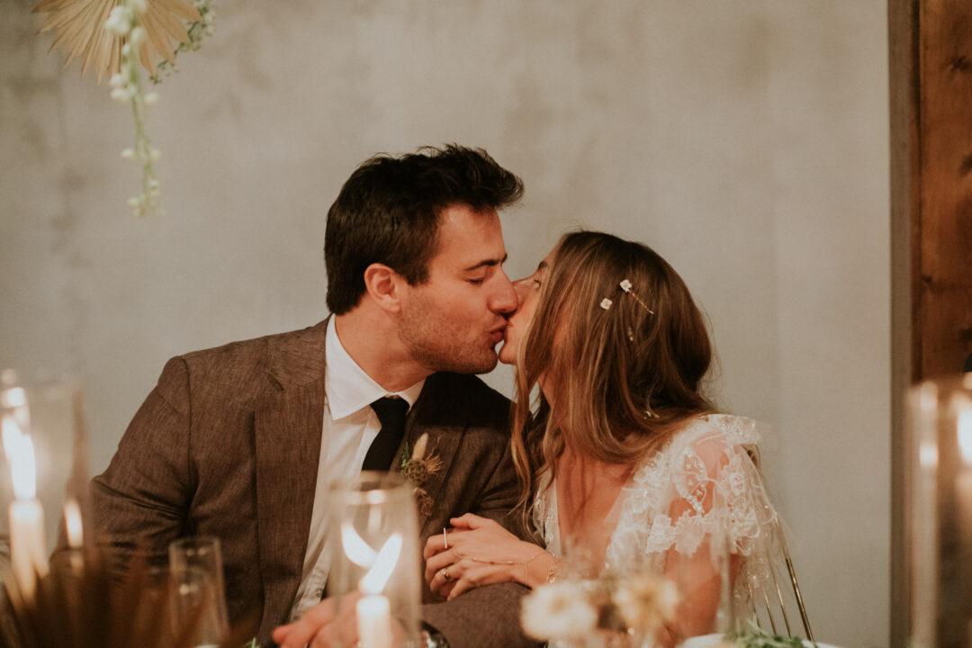 Tulum Industrial Wedding in Miami Couple Kissing under cabana