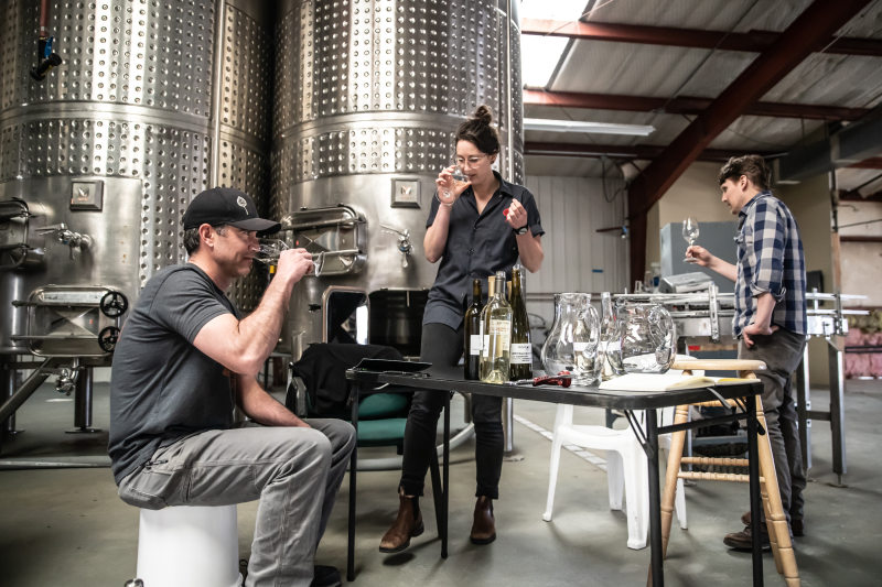 image of odell wine project wine makers tasting wine in the odell wine project production facility