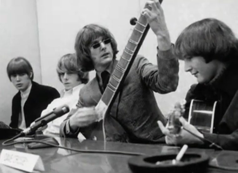 """Roger McGuinn and the Byrds at a """"raga rock"""" press conference in March 1966."""