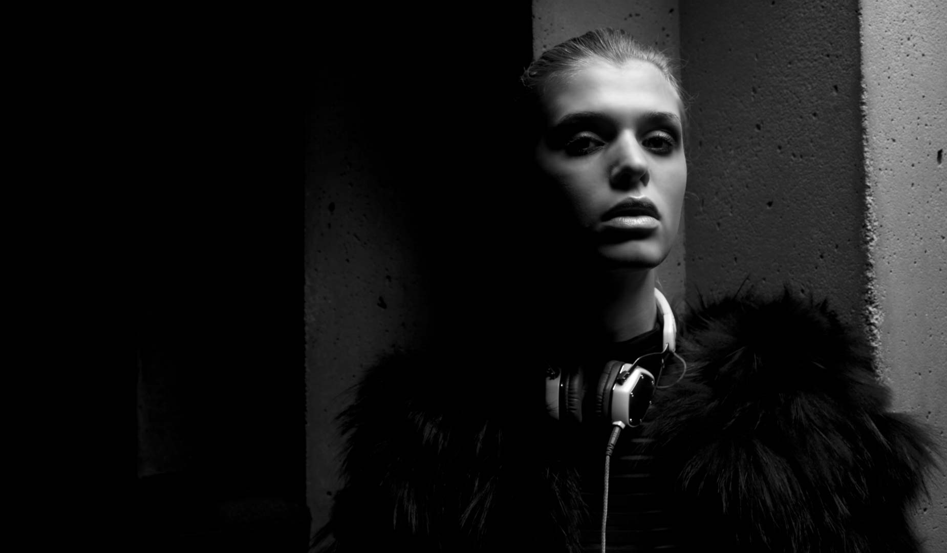 Model Wearing Headphones and Fur