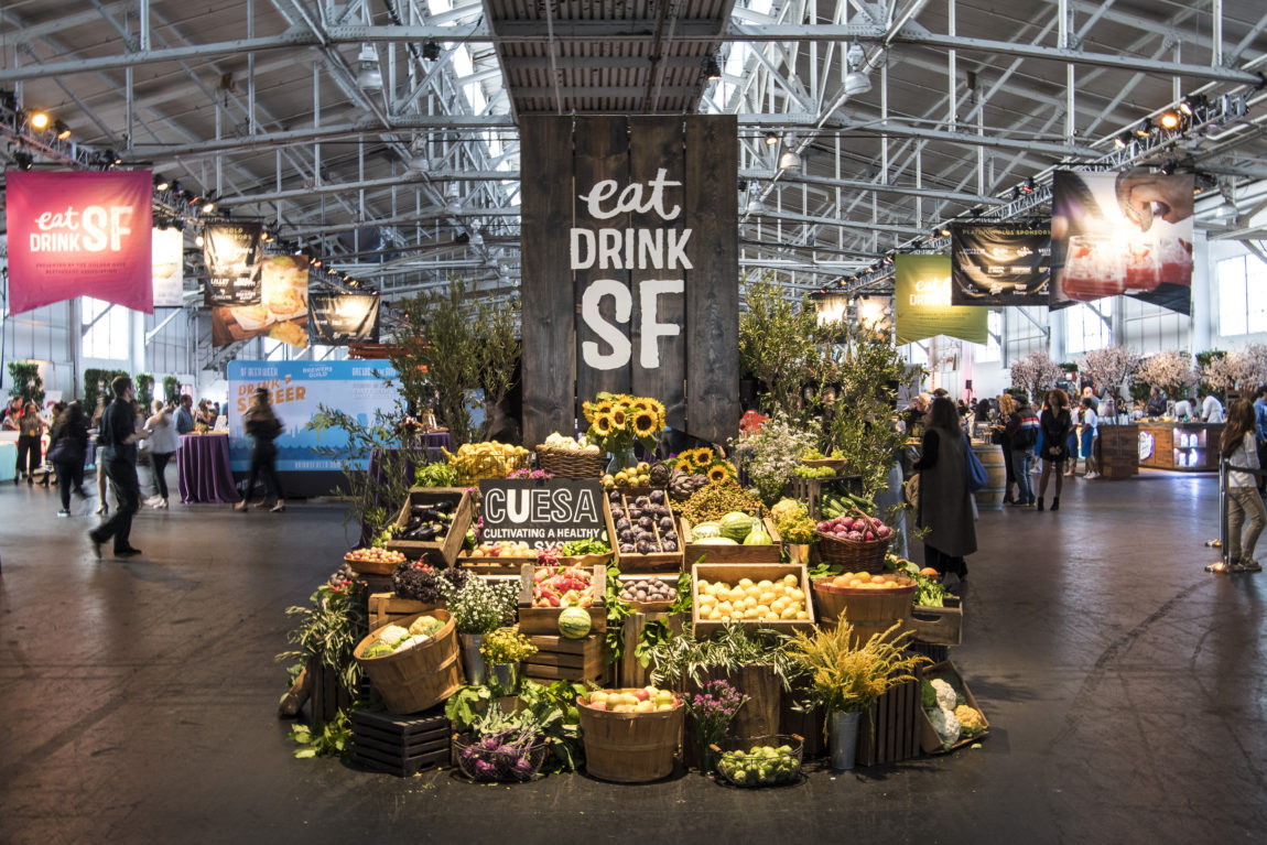 Eat Drink SF set up with fruit and veggie baskets