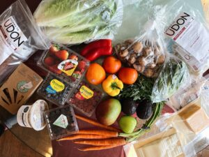 Grocery haul with fruits and vegetables.