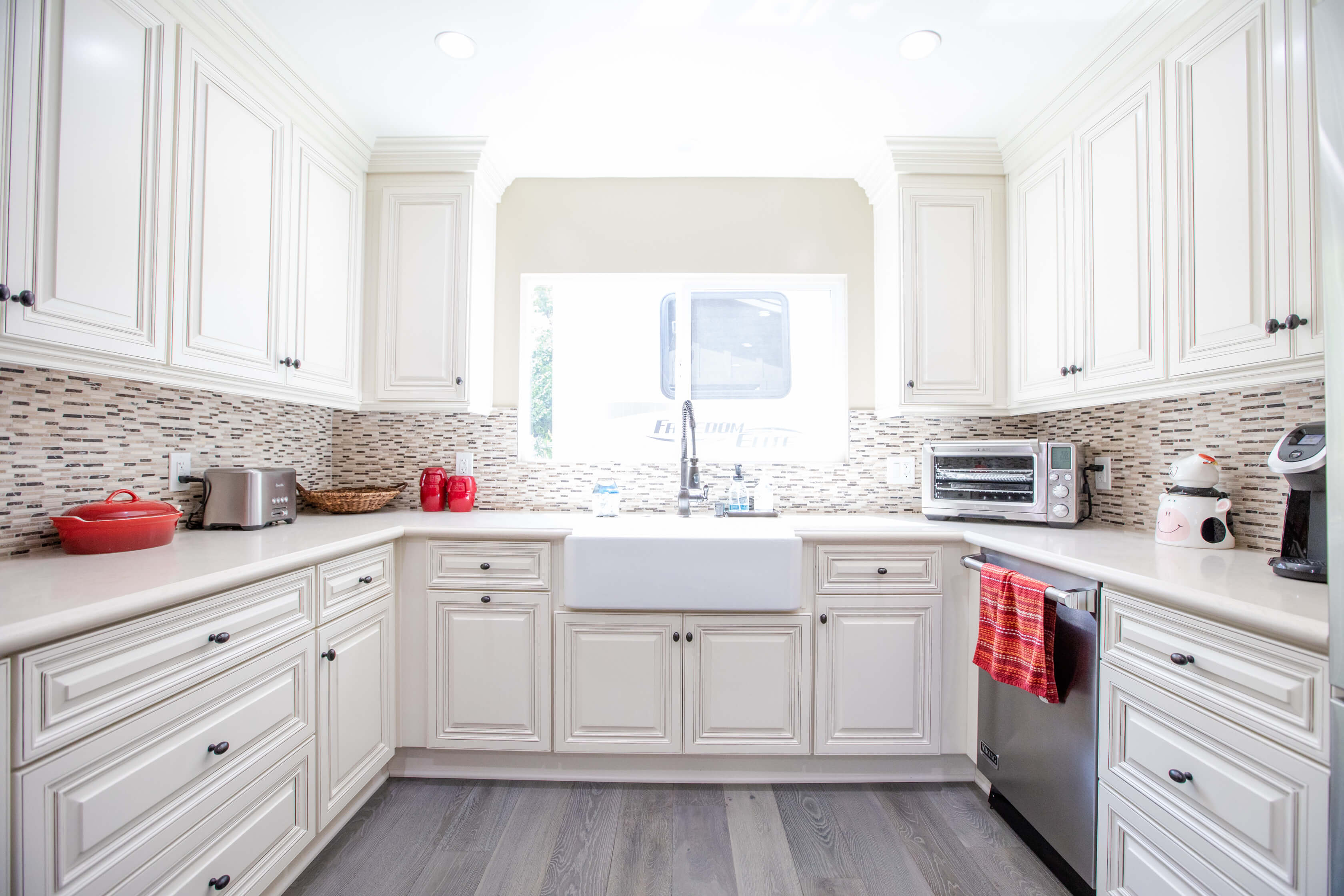Kitchen Remodel with Antique White and Mosaic Backsplash in Sherman Oaks CA