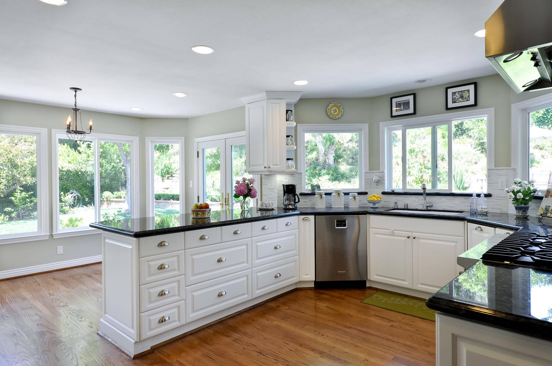 Kitchen Remodeling White Classic Raised Door with Black Granite Countertop in Oak Park CA
