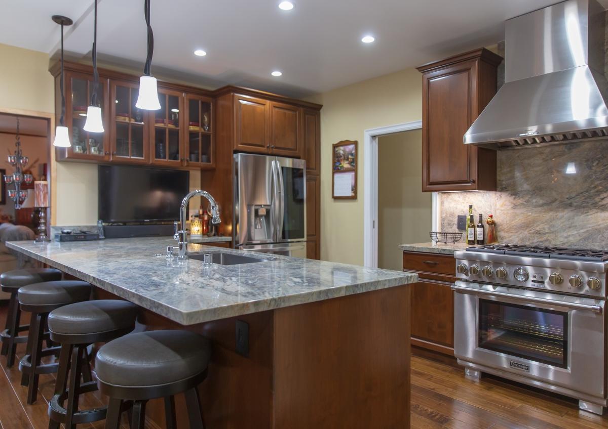 Kitchen Remodel with Dark Honey Glaze and Marble Backsplash in Los Angeles CA