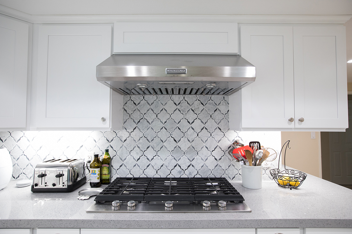 Kitchen Remodel White Shaker with Grey Island and Grey Quartz Countertop in Woodland Hills CA