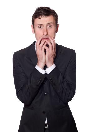 'No Sweat Public Speaking!' Afraid looking businessman