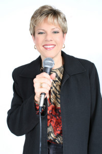 Business Woman in Black with Microphone