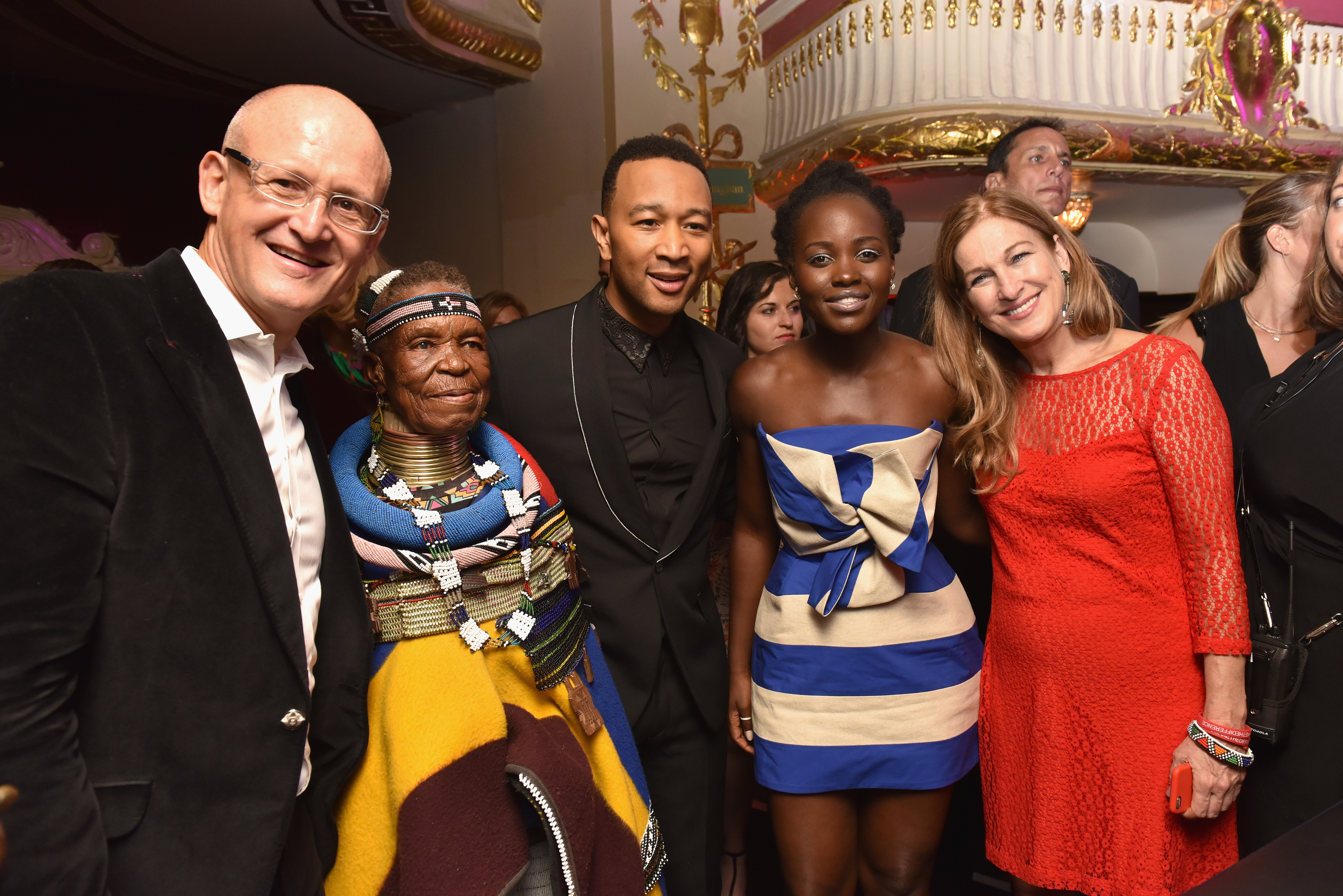 NEW YORK, NY - AUGUST 27: President of Belvedere Vodka, Charles Gibb, artist Esther Mahlangu, recording artist John Legend, actress Lupita Nyong'o, and CEO of (RED) Deborah Dugan attend the Belvedere Presents One Night for Life with John Legend at the Apollo Theater at The Apollo Theater on August 27, 2016 in New York City. (Photo by Jared Siskin/Patrick McMullan via Getty Images)