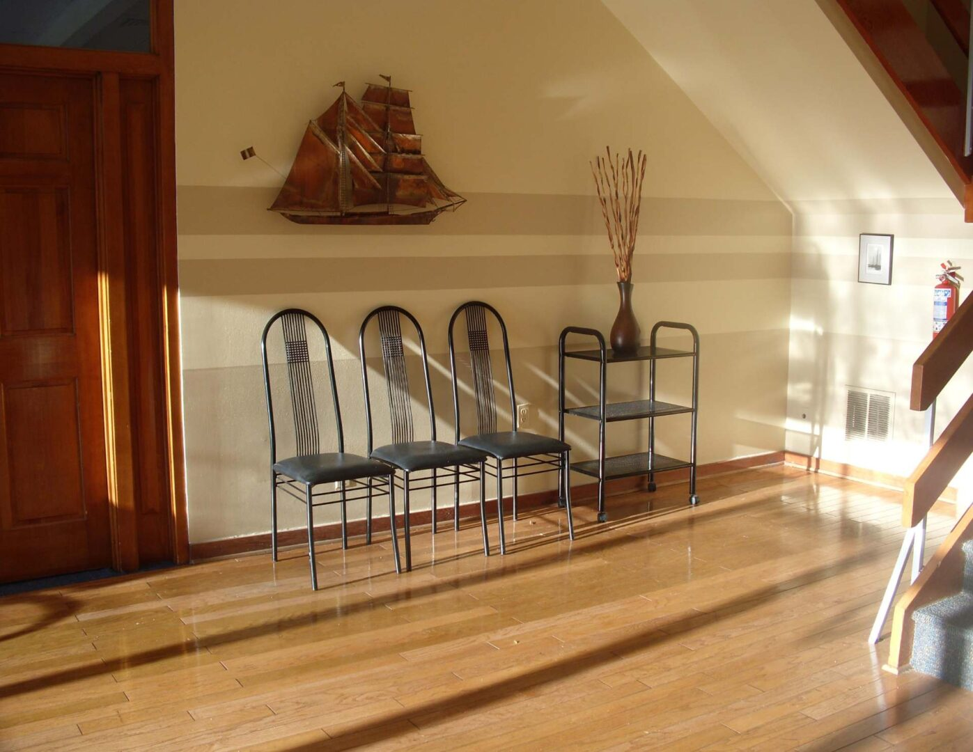 Sunlight streams in the bright, friendly lobby of office building 7 with hardwood floors and a professional shared conference room.