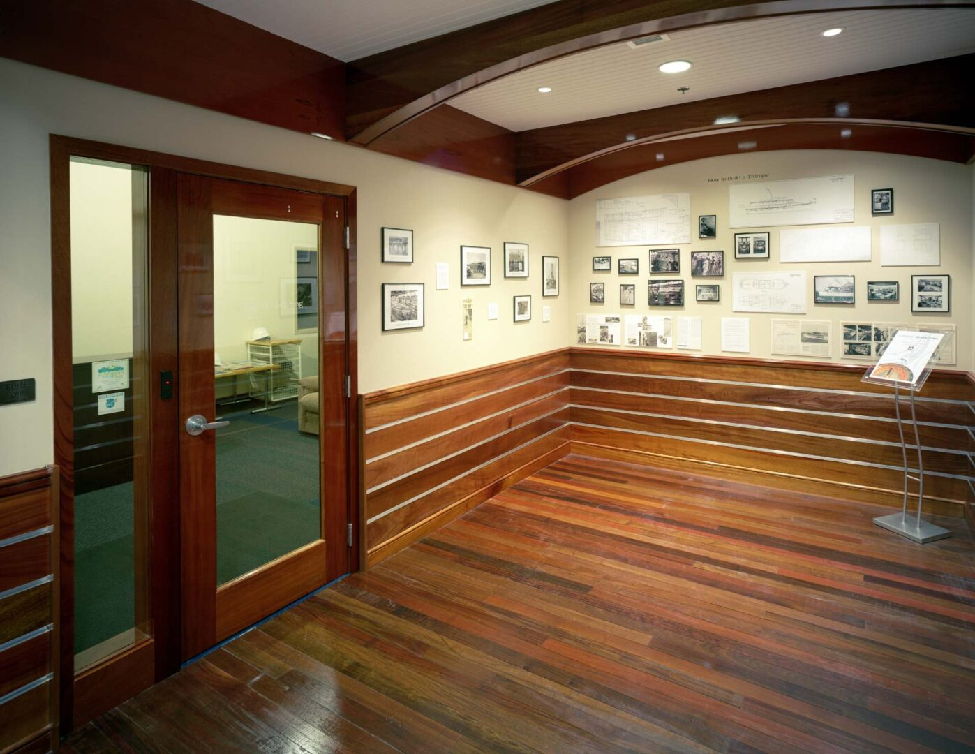 Rich mahogany half walls line the maritime-themed 2nd Floor Lobby and history museum located in the class A office building at 222 Severn.