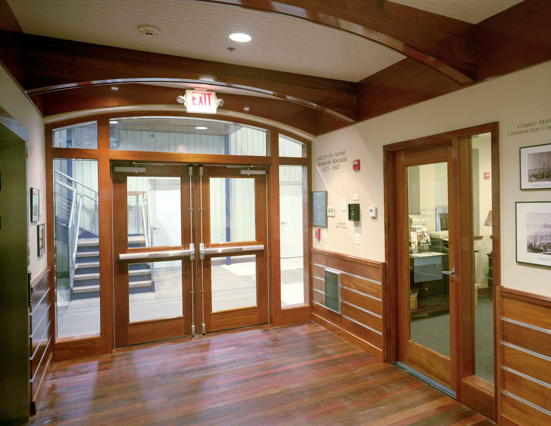 Beautiful 222 Severn Class A office lobby with mahogany interior and museum of Trumpy boat artifacts, located on the waterfront of Spa Creek in Annapolis Maryland.