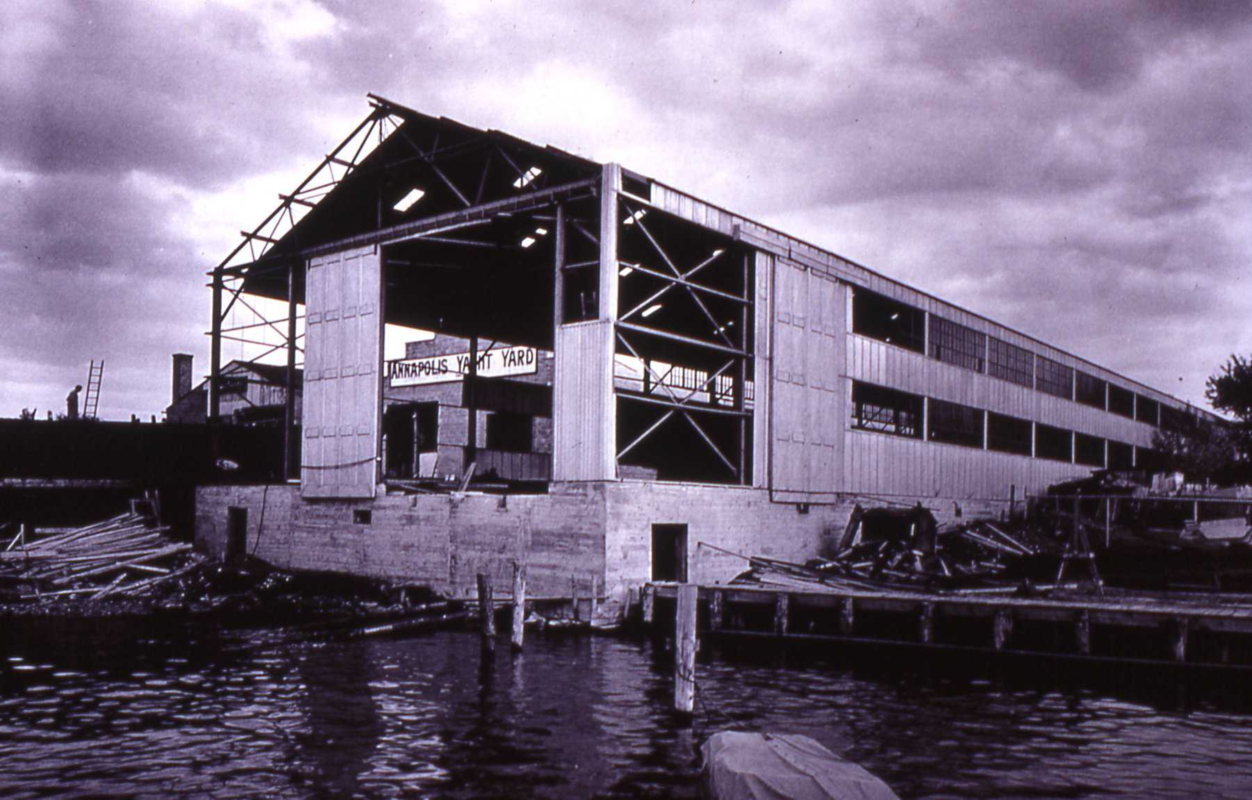 """Construction photo of """"The Big Shed"""" - a large structure created circa 1942 to house boat building for the World Wars PT boats and Trumpy Yachts in Annapolis."""