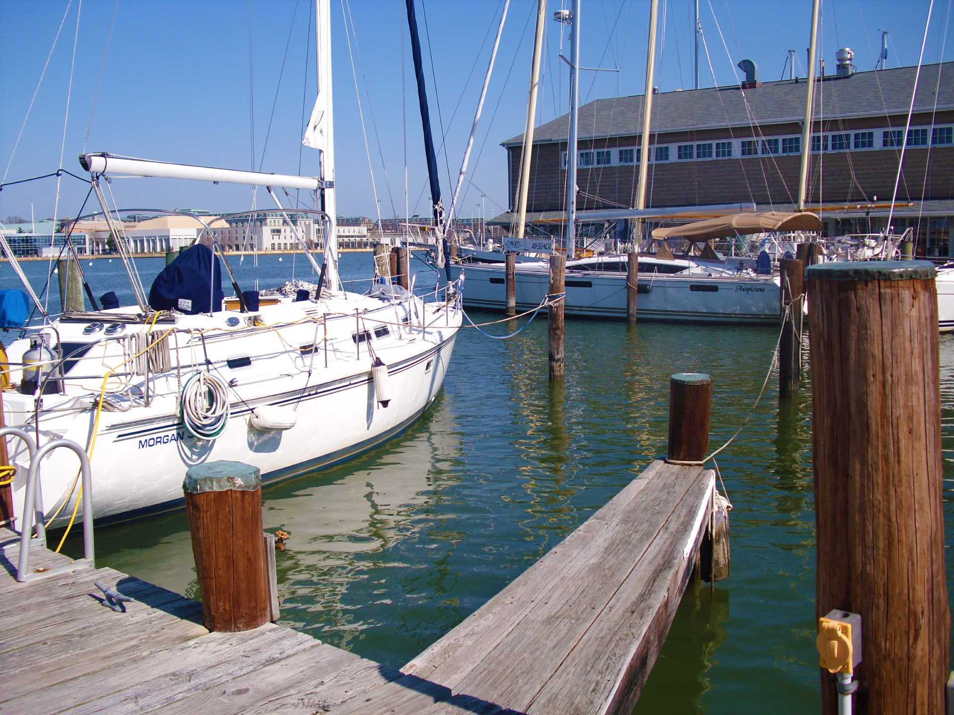 Boat slip on pier 3 at 222 Severn marina looking towards the Chart House Restaurant, U.S. Naval Academy and Annapolis on the Chesapeake Bay.