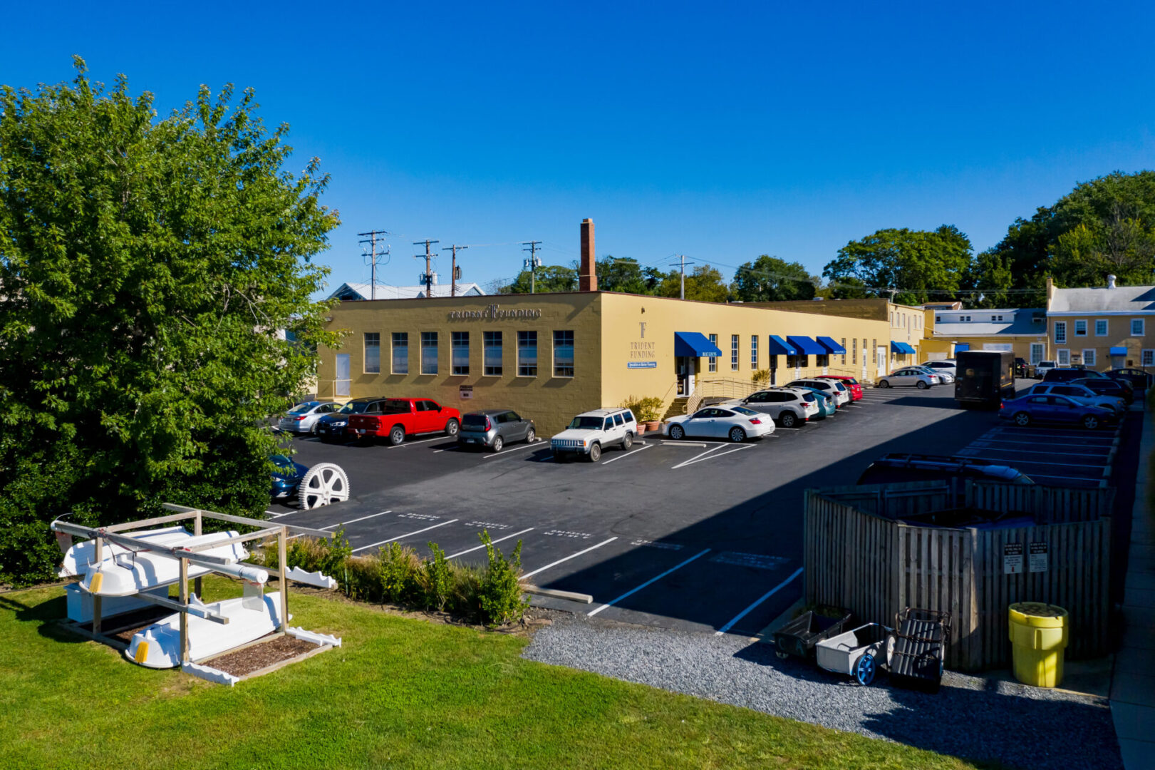 Summer day view of the picnic area and office waterfront complex at 222 Severn/W&P Nautical / The Yard on Spa Creek in Annapolis.