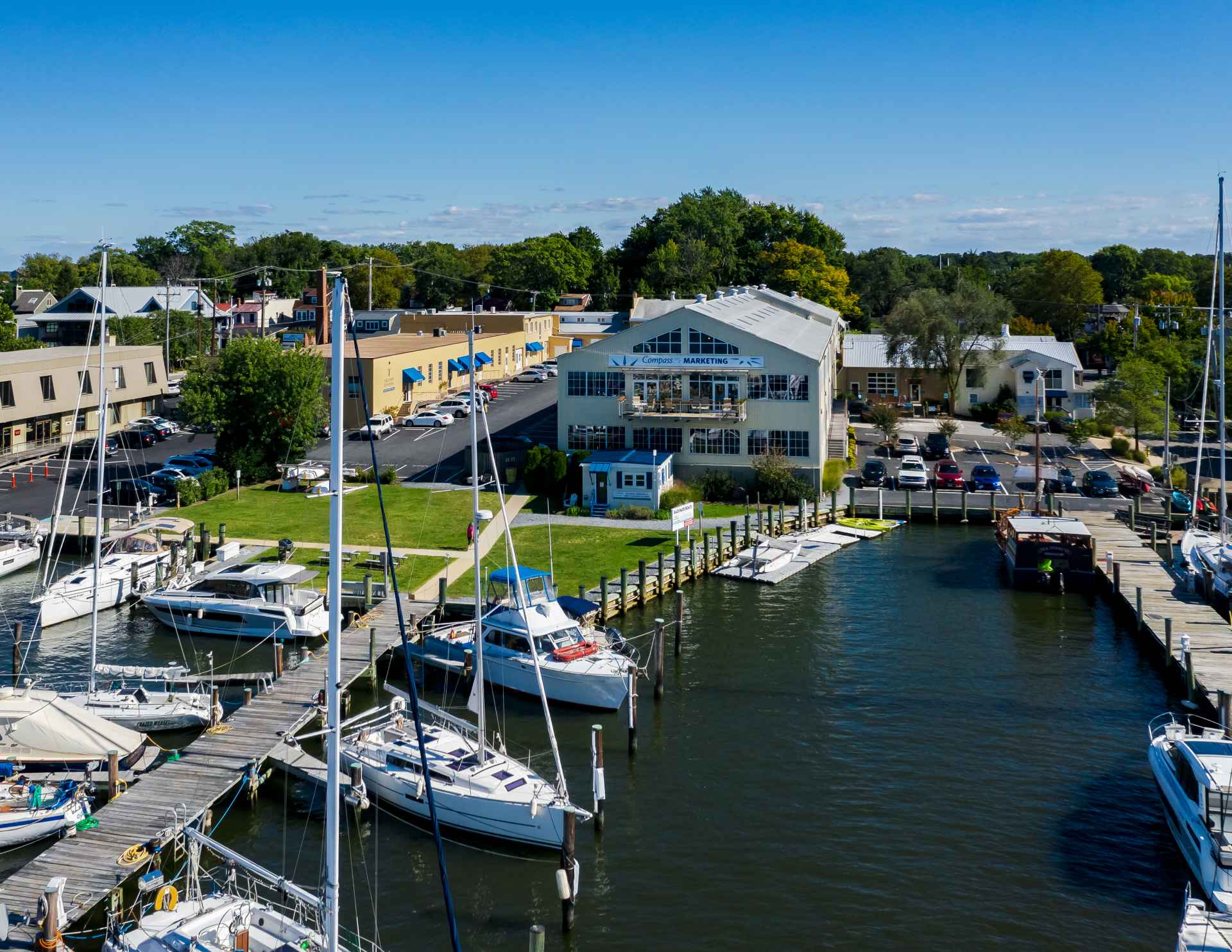 Aerial view on a summer day of Pier 3 and building 14 at the historic 222 Severn property also known as The Yard.