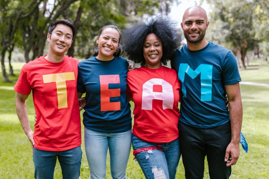 group of people wearing shirts spelled team