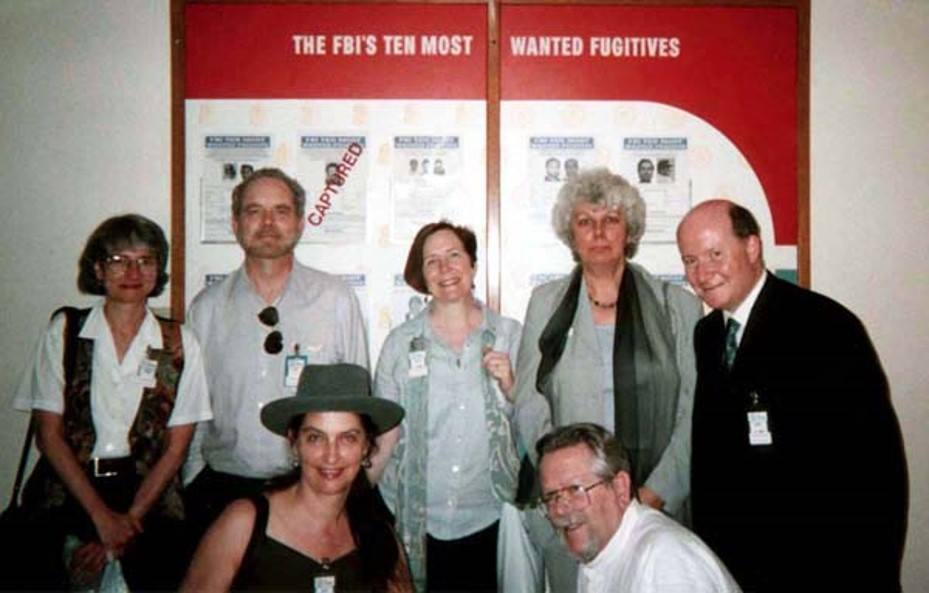 """The Director of this project, Dr. Susan J. Palmer (bottom left) with a group of scholars who were invited to the FBI's headquarters in Quantico to offer advice on millenarian groups """"acting up"""" on the eve of 2000. Top row, left to right: Catherine Wessinger, James T. Richardson, Jane Hogan, Eileen Barker (Collaborator on this project), Massimo Introvigne. Bottom row from left: Susan J. Palmer and J. Gordon Melton (Collaborator on this project)."""