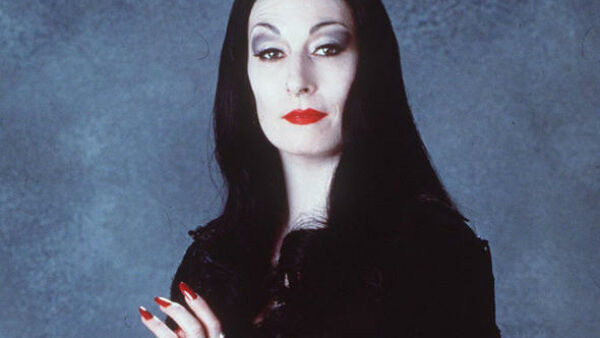 Anjelica Huston as Morticia Addams