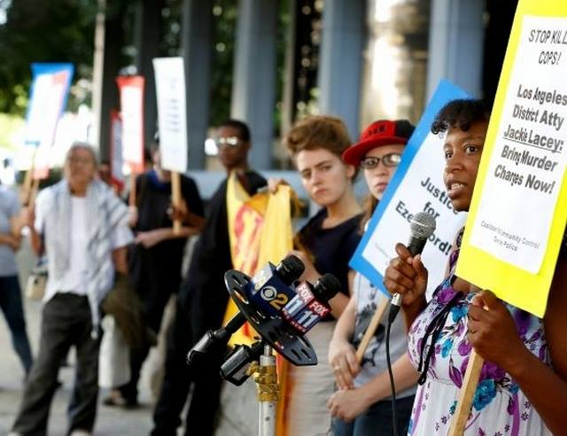 8/14- Led the first protests of D.A. Lacey.