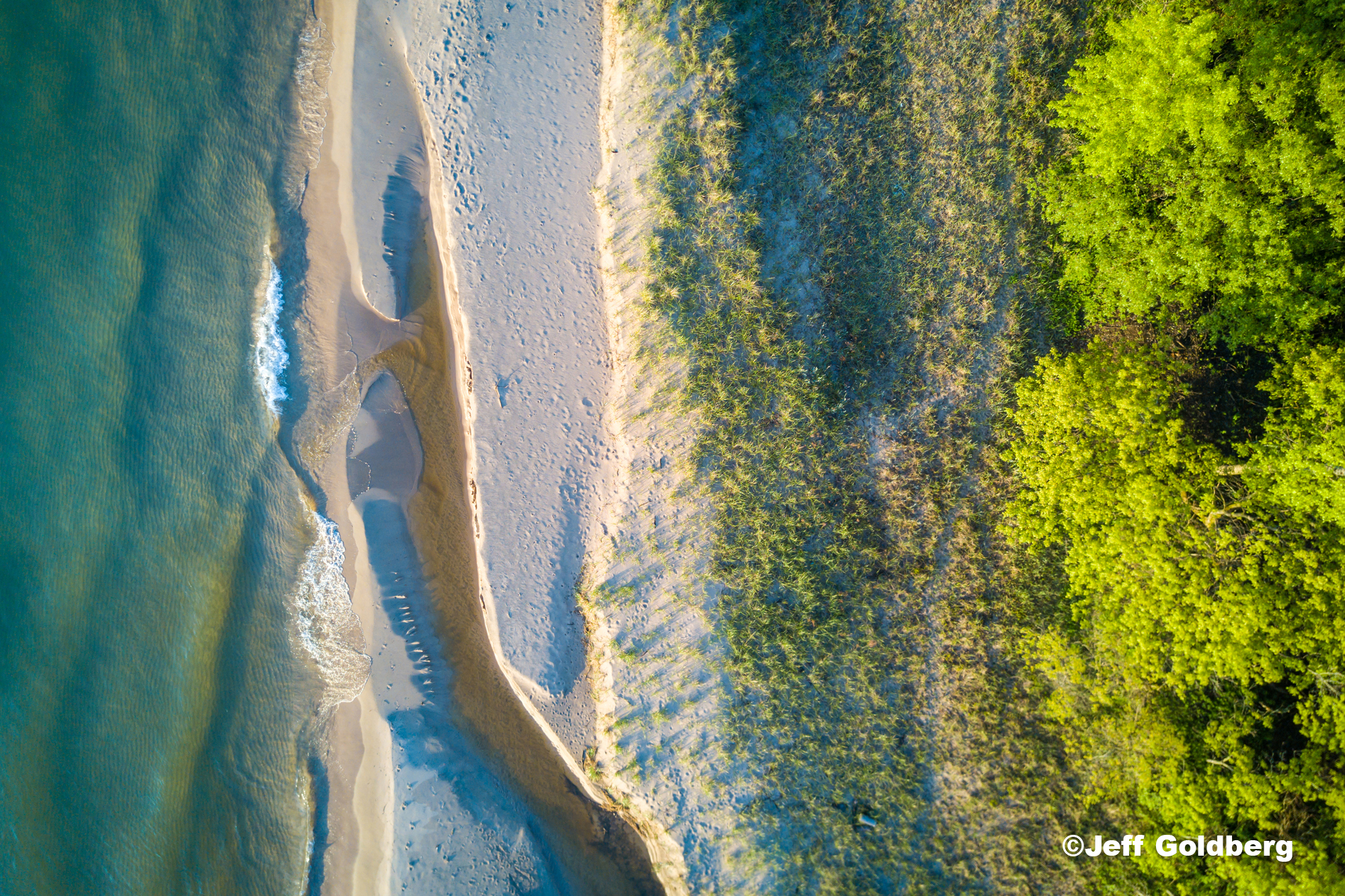 An aerial shot of sand bars on the shores of Lake Michigan