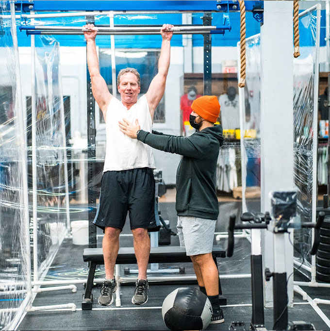 With this coach you will cover how to warm up, learn how to do some of the movements that you'll see inside of workouts, and go over all the ins & outs of what makes CFNE special.
