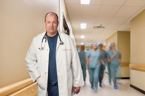Multiethnic Medical Team Walking In Hospital Corridor