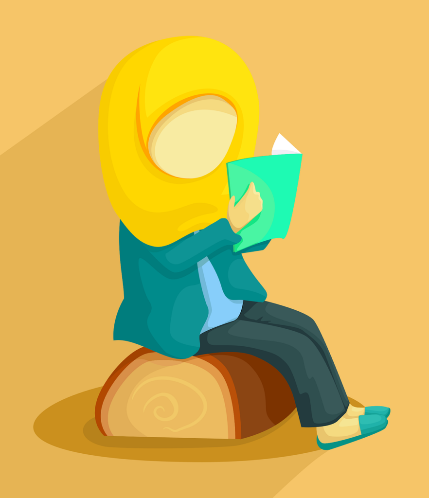 Young woman sitting on a log reading a book.