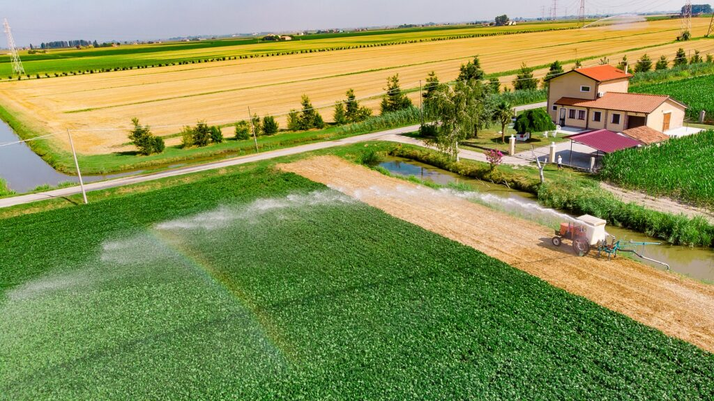 Farm field with irrigation from canal