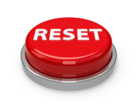 Red reset button isolated on white background, three-dimensional rendering, 3D illustration