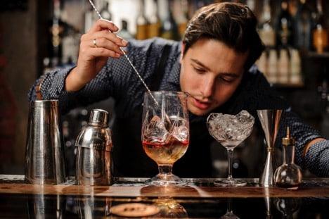 bartender pouring LibDib whisky in glass at restaurant