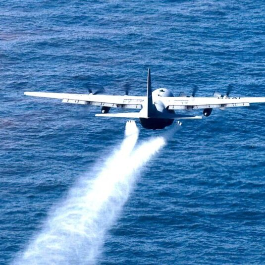 Military aircraft drops an oil-dispersing chemical into the Gulf of Mexico May 5, 2010, as part of the Deepwater Horizon Response effort. (U.S. Air Force photo/Tech. Sgt. Adrian Cadiz)