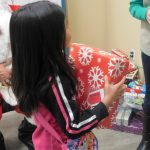 young girl just received a gift at the christmas dinner