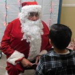 Santa-Claus giving out presents to children