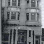 black-and-white-picture-of-front-of-an-early-PLL-home