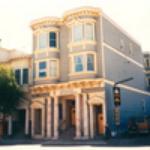 early-three-story-home-on-street-cornor
