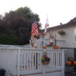 view-of-backyard-deck-with-US-Flag-displayed-behind-a-PLL-home