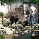 Cleaning-up-backyard-of-a PLL-home